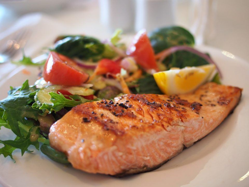 cooked salmon with a side salad for healthy hair
