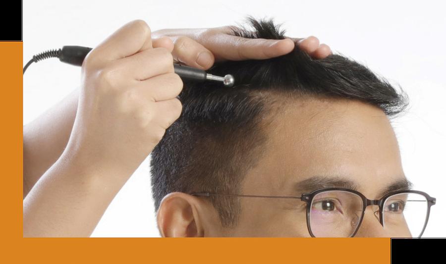 specialist performs scalp corrective treatment