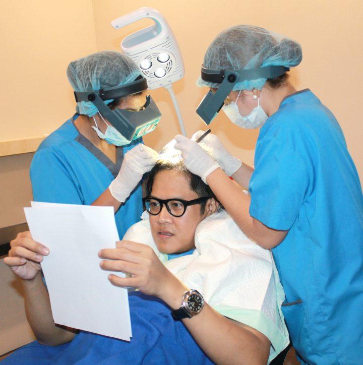 experts examine Suki Salvador's scalp
