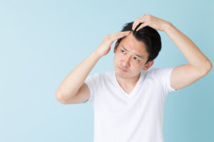 a young man experiencing hairloss